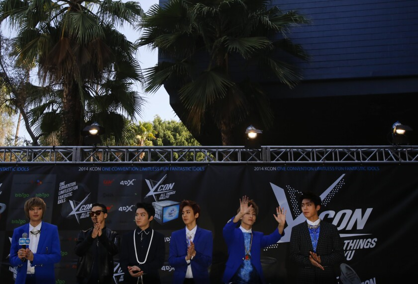The singing group Teen Top talks to a crowd of fans during an exclusive meet and greet prior to the show.