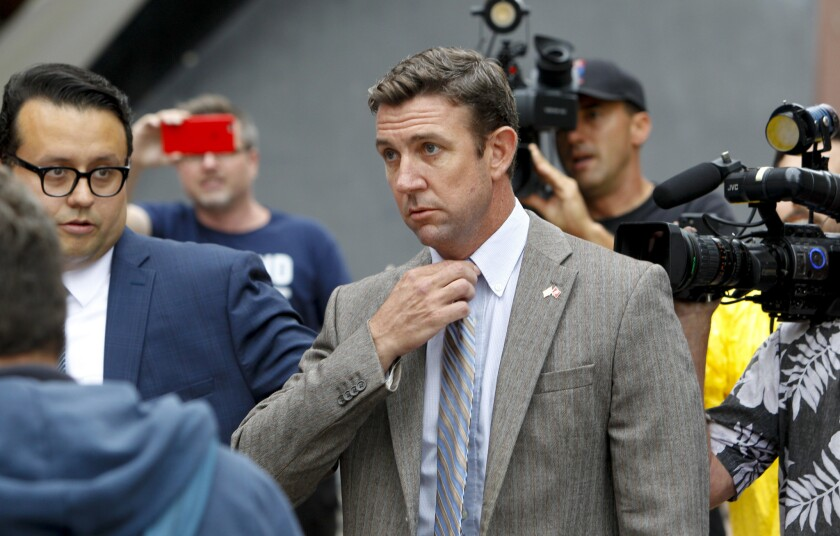 U.S. Rep. Duncan Hunter (R-Alpine) leaves a San Diego federal courthouse last month after a hearing. He and his wife face federal charges of misspending political donations on personal items.