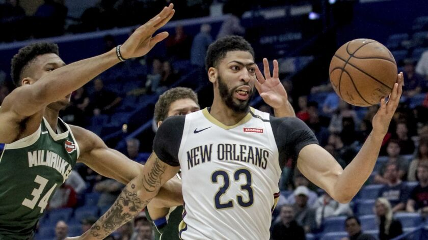 FILE - In this Tuesday, March 12, 2019 file photo, New Orleans Pelicans forward Anthony Davis (23) t