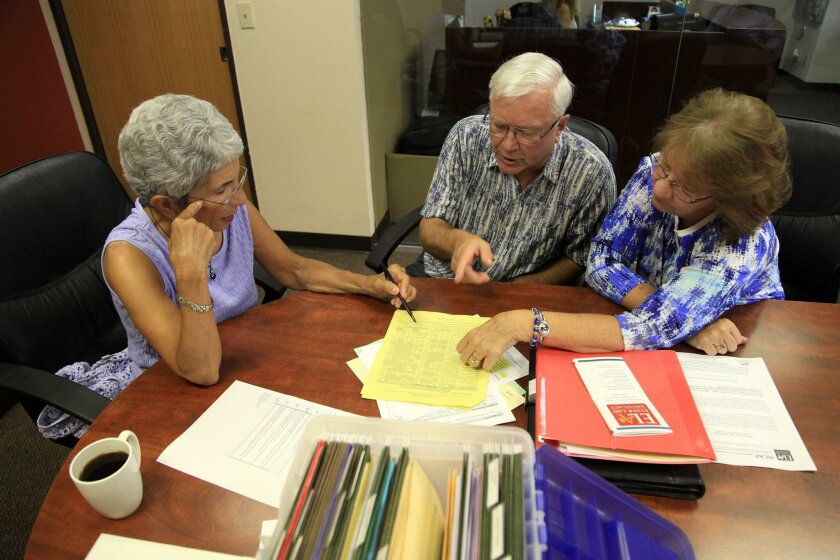 Having recently retired, Gary Krug and Lenore Krug of Mira Mesa get Medicare from volunteer counselor Alice Fichandler at Elder Law & Advocacy legal services in San Diego.