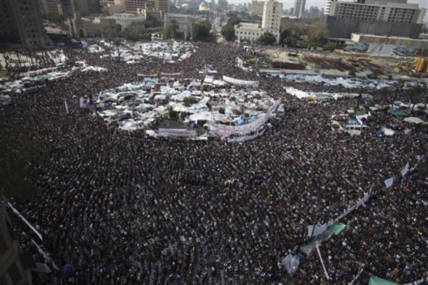 Anti-government protesters make traditional Muslim Friday prayers at the continuing demonstration in Tahrir Square in downtown Cairo, Egypt, Friday, Feb. 11, 2011. (AP Photo/Tara Todras-Whitehill)