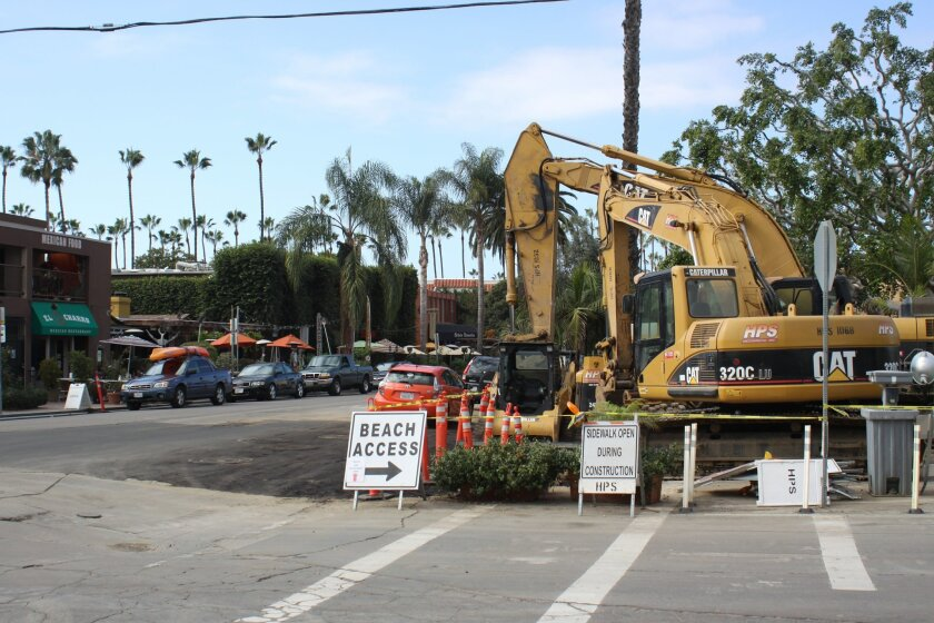 Leading up to the sewer and water main replacement on Avenida de la Playa, construction equipment is stationed near the main thoroughfare.