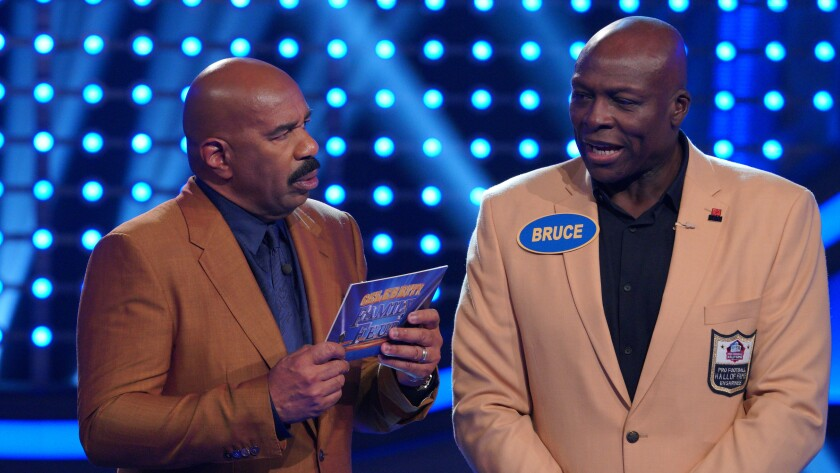 """Steve Harvey, left, and Bruce Smith in """"Celebrity Family Feud"""" on ABC."""