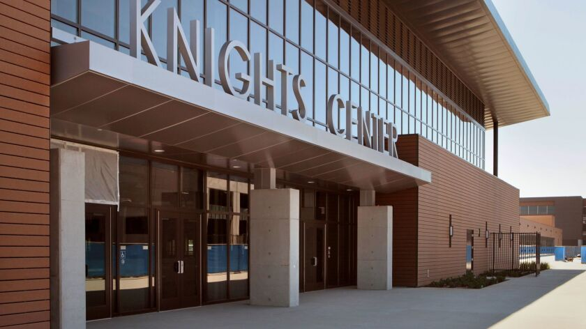 View of the front of the recently completed Knights Center gymnasium building at San Marcos High School. The school is being rebuilt.