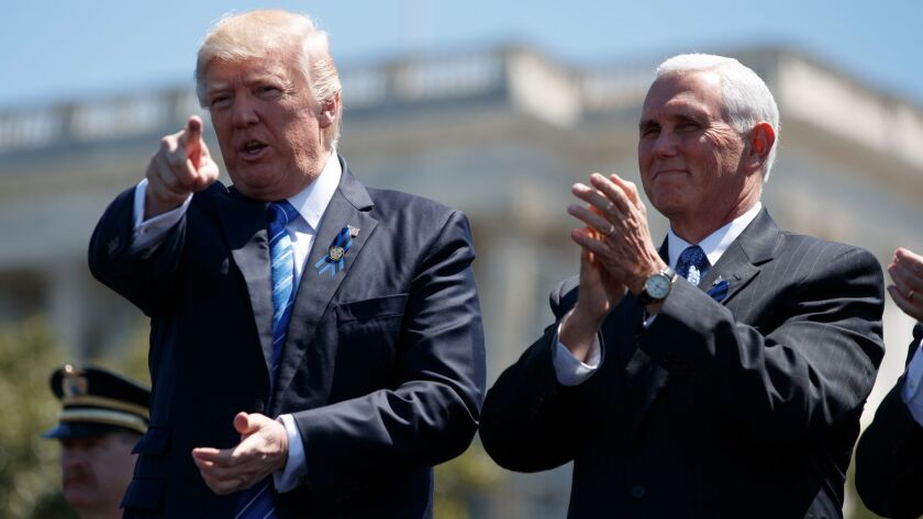 President Donald Trump stands with Vice President Mike Pence during the 36th annual National Peace O