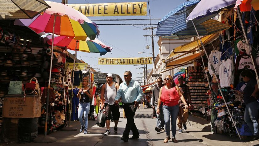 LOS ANGELES, CA - JUNE 14, 2017 - Shoppers crowd Santee Alley in the Fashion District near the forme