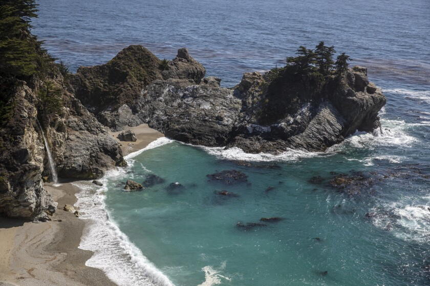 McWay Falls, at left, drops to the sandy shore at Julia Pfeiffer Burns State Park on the Big Sur coast along California 1.