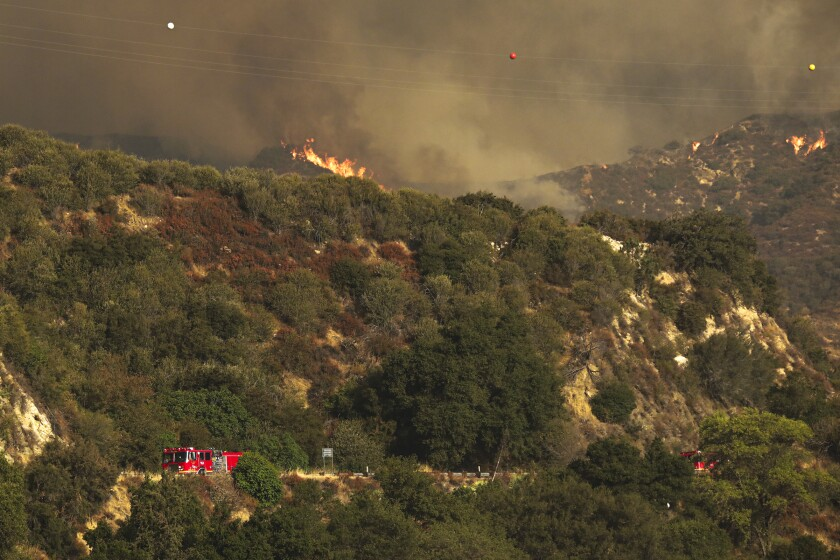 The Bobcat fire rages above Rincon Fire Station on Highway 39 on Wednesday in the San Gabriel Mountains.