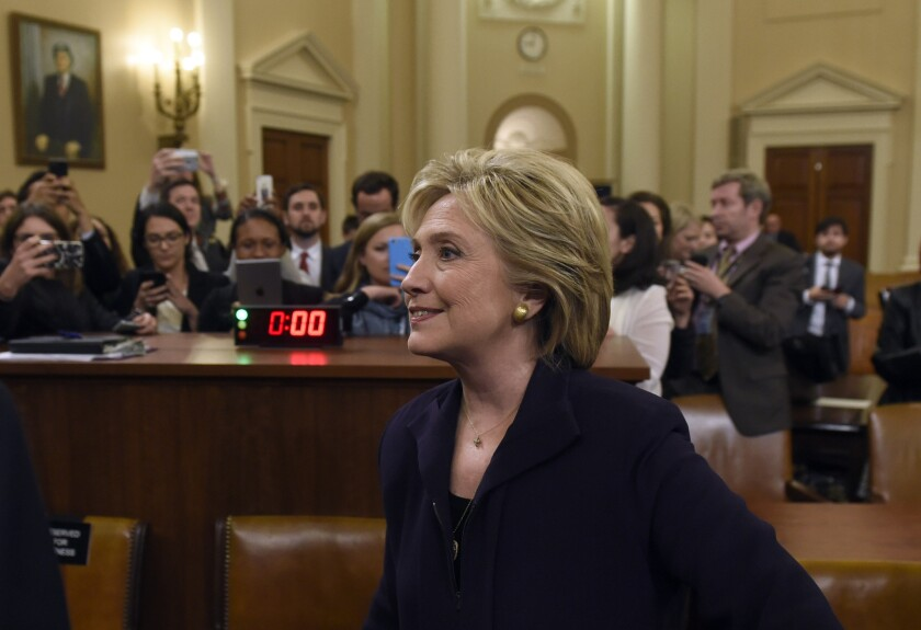 Former Secretary of State Hillary Rodham Clinton leaves after she testified before the House Select Committee on Benghazi on Capitol Hill on Oct. 22.