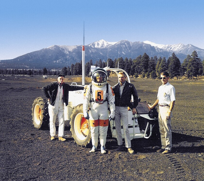USGS Field Test Support Unit (left to right) Dick Wiser, John Hendricks, Bill Tinnin and Putty Mills with the Explorer, a lunar rover vehicle simulator at Cinder Lake Crater Field east of Flagstaff, December 1968.