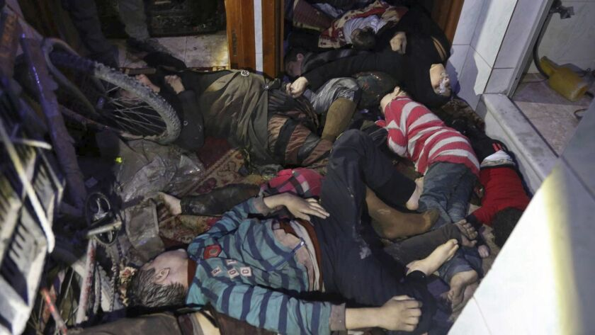 EDS NOTE: GRAPHIC CONTENT - This image released early Sunday, April 8, 2018 by the Syrian Civil Defe