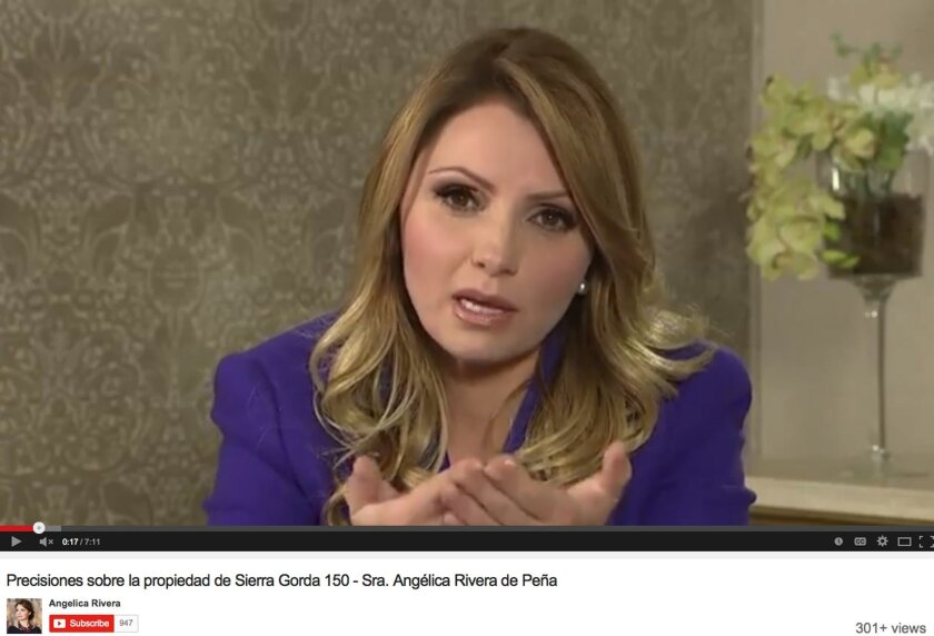 In a YouTube video posted on the personal website of Mexico's first lady, Angelica Rivera tries to clarify a scandal over her purchase of a mansion from a government contractor, saying she used her own money in the deal and plans to get rid of the $7-million home.