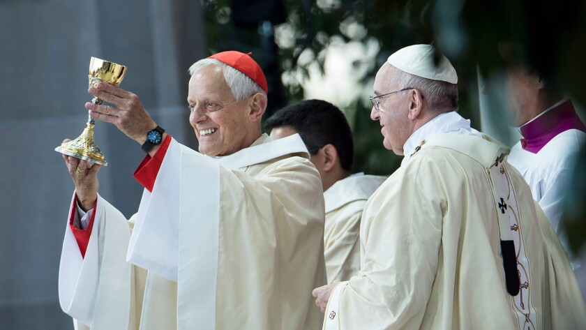 Cardinal Donald Wuerl, left, the archbishop of Washington, D.C., and Pope Francis celebrate a 2015 canonization Mass for the Rev. Junipero Serra in Washington.