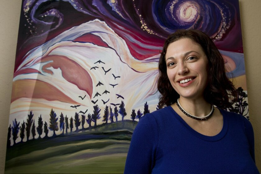 Artist Cedar Lee in front of one of her paintings at her home in Escondido, where she hosts a monthly meeting of artists. Hayne Palmour IV • U-T