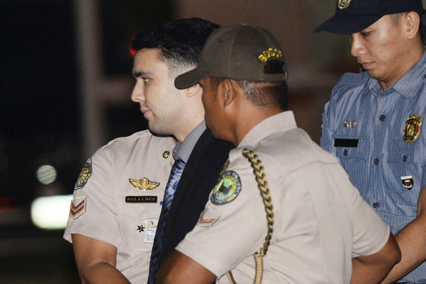 U.S. Marine Lance Cpl. Joseph Scott Pemberton is escorted to his detention cell in the Philippines in December 2015.