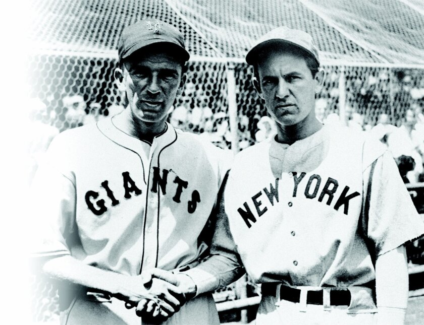 Carl Hubbell of the Giants, left, and Vernon Gomez of the Yankees, shown before they started the day for the All-Star teams in New York City July 10, 1934.  (AP Photo)