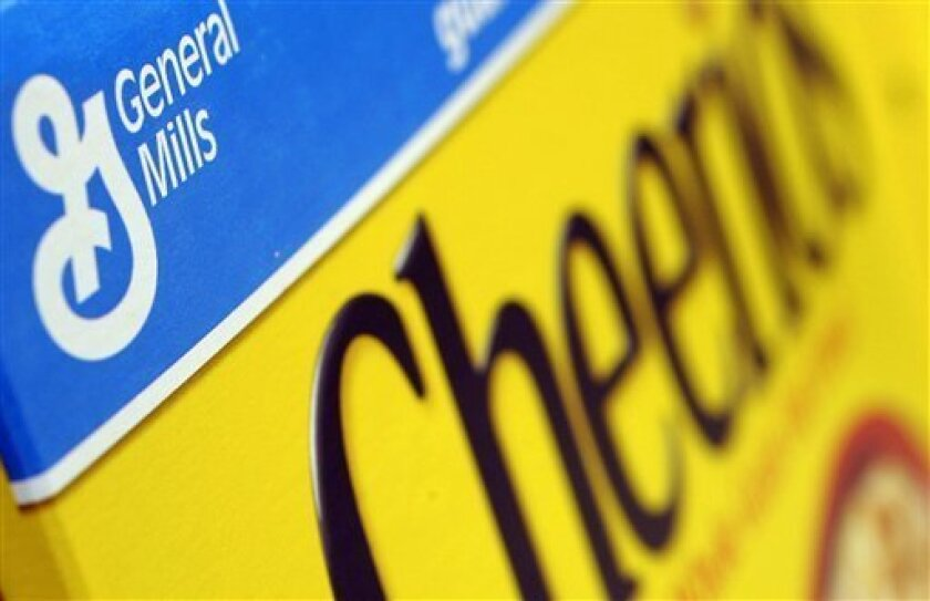 In this Dec. 15, 2007 file photo, a box of General Mills' Cheerios is seen on a shelf at a Shaw's Supermarket in Gloucester, Mass. Cereal maker General Mills Inc. said Wednesday, Dec. 17, 2008, its second-quarter profit slipped 3 percent, but adjusted results beat expectations as costs of key ingredients moderated and more consumers reached for its Yoplait Yogurt, Cheerios and Progresso Soup brands. (AP Photo/Lisa Poole, file)