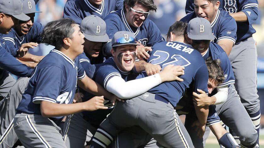LOS ANGELES, CALIF. - MAY 25, 2019. The Birmingham High School baseball team swarms pitcher Sebastia