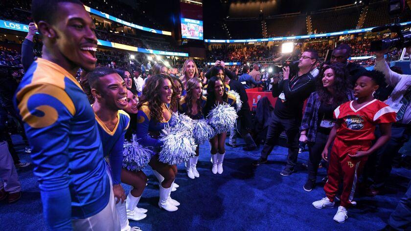 Rams male cheerleaders Quinton Peron, left, and Napoleon Jinnies.