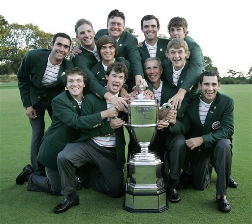 Members of the USA team pose with golf's Walker Cup during the trophy presentation Sunday, Sept. 13, 2009, at Merion Golf Club in Ardmore, Pa. USA defeated Great Britain and Ireland team for their third straight title. (AP Photo/Mel Evans)