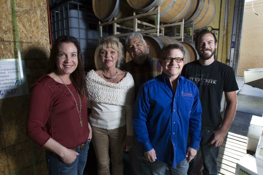The new owners of Carlsbad's Witch Creek Winery, Maureen Coomber, Dru White, Mayur Pavagadhi and Skip Coomber with winemaker Ryan Scott, far right.