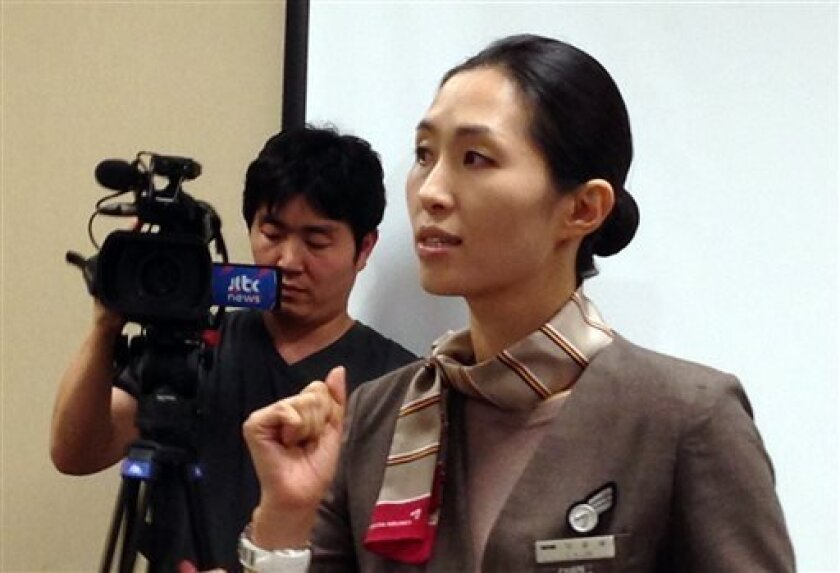 Asiana Airlines Flight 214 flight attendant and cabin manager, lee yoon Hye, speaks to the media during a news conference in San Francisco, Sunday, July 7, 2013. Flight 214 crashed on landing at San Francisco International Airport on Saturday, killing two people and injuring dozens. Lee was describ