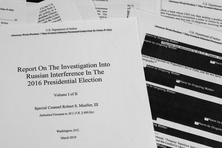 FILE - In this April 18, 2019, file photo, special counsel Robert Mueller's redacted report on Russian interference in the 2016 presidential election is photographed in Washington. The Justice Department must give to Congress secret grand jury testimony from special counsel Robert Mueller's Russia investigation, a federal appeals court ruled Tuesday, March 10, 2020. (AP Photo/Jon Elswick, File)