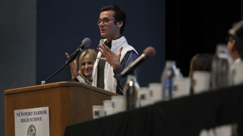 Senior Johnny Lujan, a One-On-Campus ambassador at Corona del Mar High School, speaks during an awareness panel presented by One Recovery on Wednesday night at Newport Harbor High School in response to a recent off-campus student party featuring Nazi symbols.