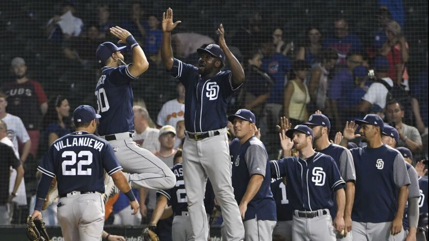 The Padres celebrate their victory over the Cubs on Thursday.