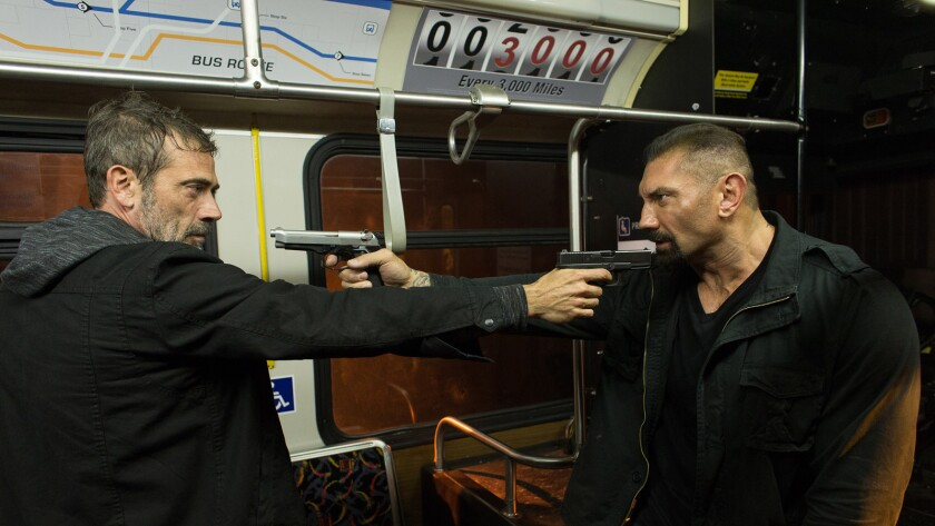 """Jeffrey Dean Morgan, left and Dave Bautista in a scene from """"Heist."""""""
