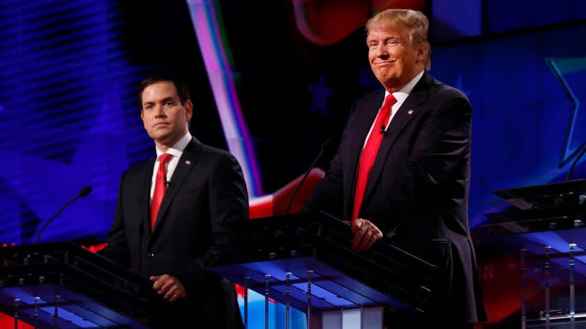 """Marco Rubio and Donald Trump appear together onstage at a debate in March. Rubio, who has called Trump a """"con artist"""" and said he had """"no ideas of any substance"""" on the major issues, recently endorsed the front-runner."""