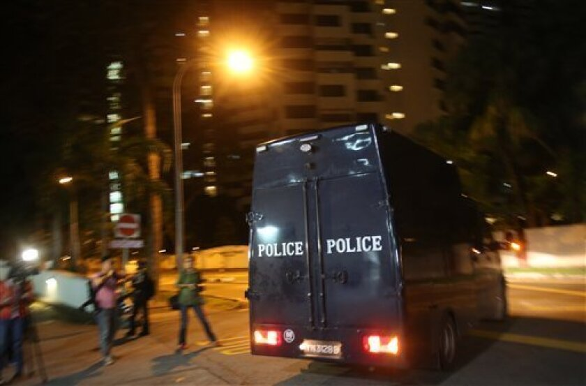 A police hearse leaves Mount Elizabeth Hospital on Saturday Dec. 29, 2012 in Singapore. A young Indian woman who was gang-raped and severely beaten on a bus in New Delhi died Saturday at the hospital, after her horrific ordeal galvanized Indians to demand greater protection from sexual violence tha