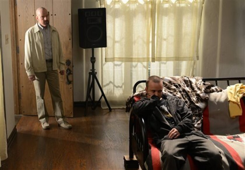 """This TV publicity image released by AMC shows Bryan Cranston as Walter White, left, and Aaron Paul as Jesse Pinkman in a scene from """"Breaking Bad."""" The final season premiered on Sunday, Aug. 11. (AP Photo/AMC, Ursula Coyote)"""