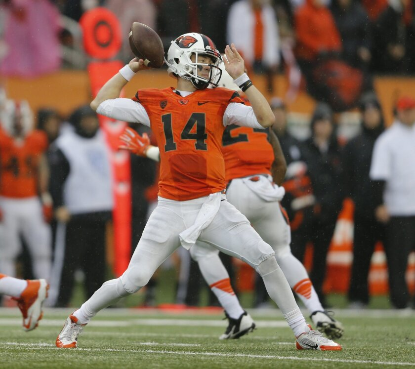 Oregon State quarterback Nick Mitchell throws a pass in the second half of an NCAA football game against UCLA, in Corvallis, Ore., on Saturday, Nov. 7, 2015. UCLA won 41-0. (AP Photo/Timothy J. Gonzalez)