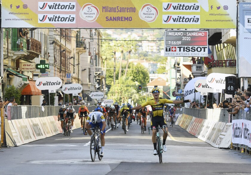 Belgium's Wout Van Aert, right, sprints ahead of France's Julian Alaphilippe to win the Milan to Sanremo cycling race, in San Remo, Italy, Saturday, Aug. 8, 2020. (Gian Mattia D'Alberto/LaPresse via AP)