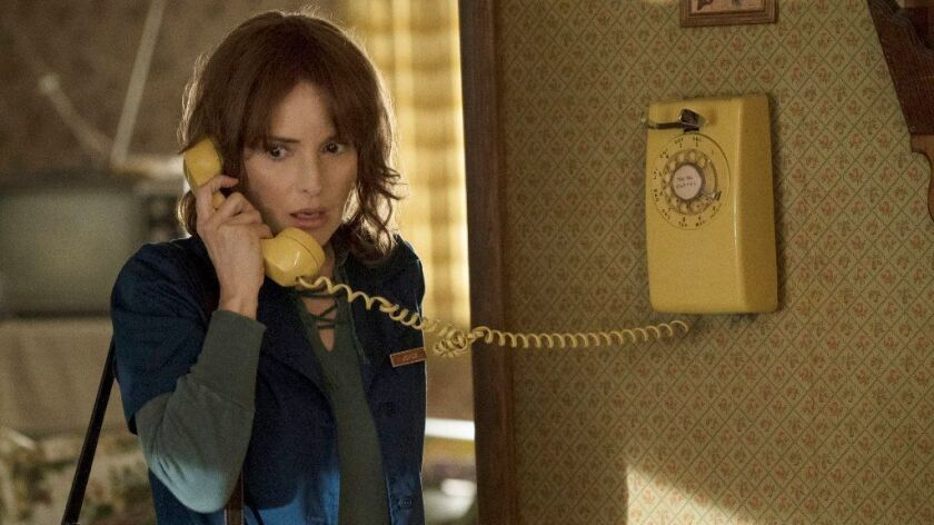 """Winona Ryder gets a phone call -- probably not from the television academy -- in """"Stranger Things."""""""