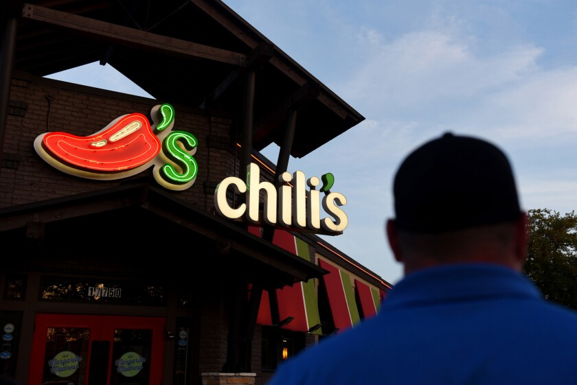 A customer walks toward the entrance of a Chili's Grill & Bar restaurant in San Antonio, Texas, on May 7, 2018.