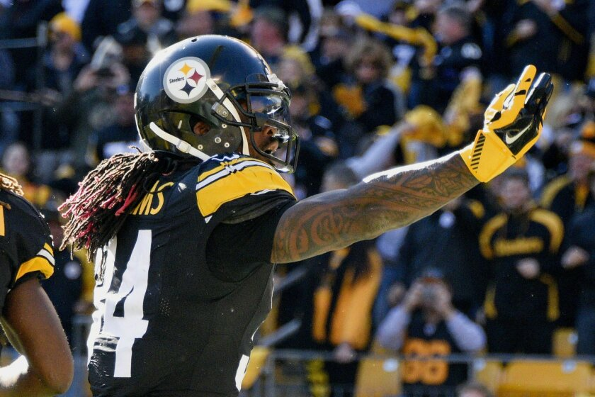 Pittsburgh Steelers running back DeAngelo Williams (34) celebrates after scoring a touchdown in the first half of an NFL football game against the Oakland Raiders, Sunday, Nov. 8, 2015, in Pittsburgh. (AP Photo/Don Wright)