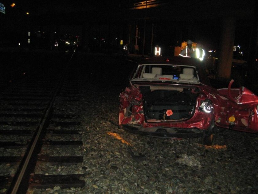 A car was hit by a train in Midtown Wednesday night. The car was stuck on the railway after the driver mistakenly  took a left-hand turn while listening to her GPS.