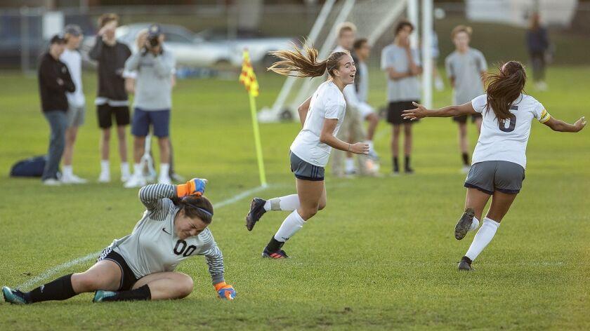 Corona del Mar's goalie Giovanna Broderick slams her fist to the ground as Newport Harbor's Sofia Ve