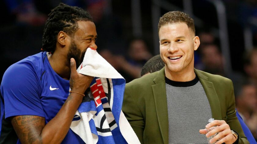 Clippers forward Blake Griffin and center DeAndre Jordan share a laugh on the bench during a Dec. 20 game against the Phoenix Suns at Staples Center.