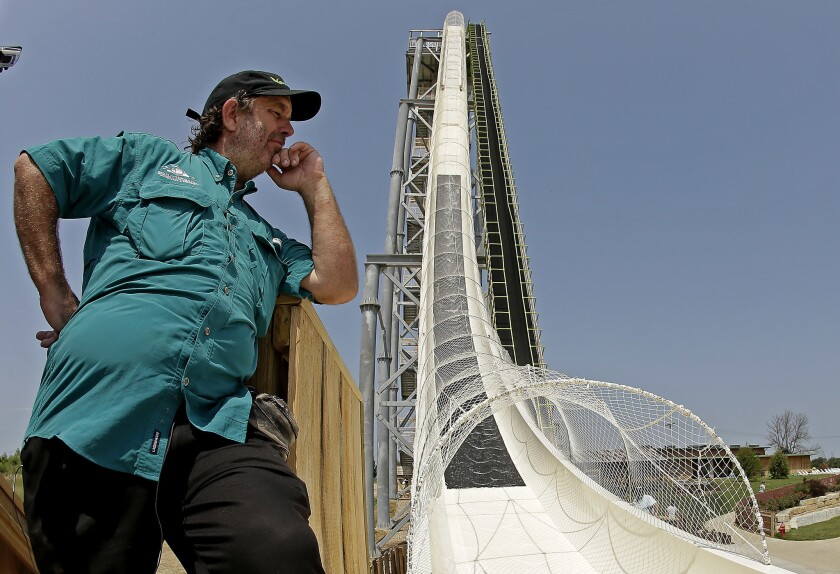 Jeffrey Henry looks over Verruckt, the world's tallest waterslide at the time, at Schlitterbahn Waterpark in Kansas City, Kan., in 2014.