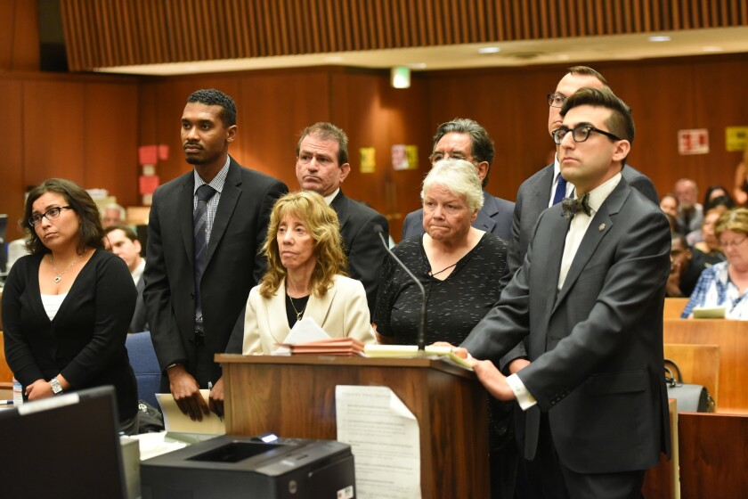 Arraignment of four social workers charged with child abuse in the death of an 8-year-old boy.