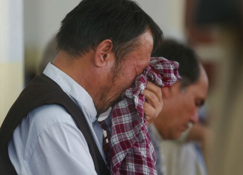 A man weeps Aug. 21 during a memorial service for victims of a wedding hall bombing in Kabul, Afghanistan.