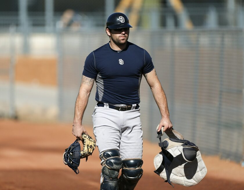 Padres prospect Cody Decker walks to the practice facility as the first day of spring training began for the Padres with pitchers and catchers reporting for their physicals.