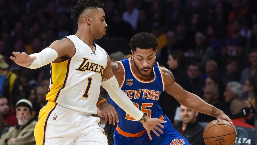Derrick Rose drives against D'Angelo Russell (1) during a Knicks-Lakers game last season.