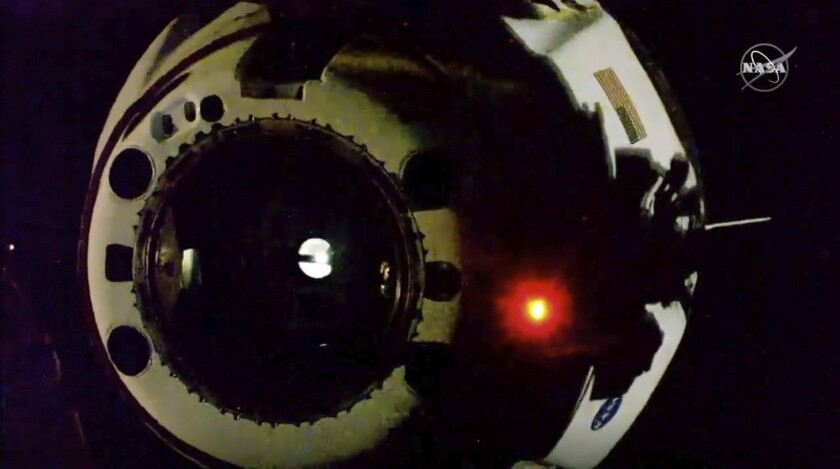 In this image from video made available by NASA, the SpaceX Crew Dragon capsule separates from the International Space Station on Saturday, Aug. 1, 2020. (NASA via AP)