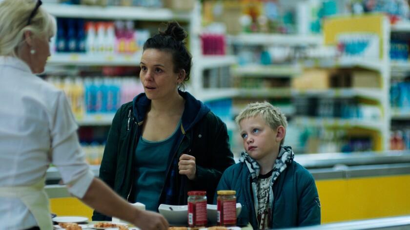 """Kristín Thóra Haraldsdóttir and Patrik Nökkvi Pétursson in the film """"And Breathe Normally."""""""