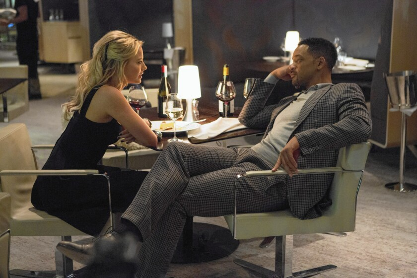 "Margot Robbie and Will Smith in ""Focus."""