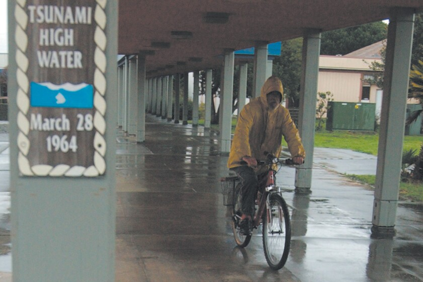 A man rides his bicycle in 2004 in Crescent City, where a 1964 earthquake spawned a deadly tsunami.